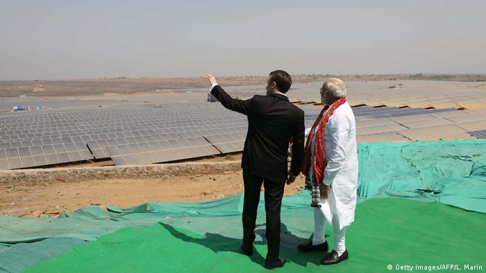 Indian Prime Minister Narendra Modi (R) and French President Emmanuel Macron stand together during the inauguration of a solar power plant in Mirzapur in Uttar Pradesh state on March 12, 2018