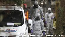 Investigators in protective clothing remove a van from an address in Winterslow, Wiltshire, as part of their investigation into the nerve-agent poisoning of ex-spy Sergei Skripal and his daughter, in England, Monday, March 12, 2018. British Prime Minister Theresa May will update lawmakers Monday on Skripal and his daughter, and a senior lawmaker said he expects her to blame the Russian government. (Andrew Matthews/PA via AP) |