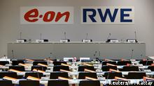 13.03.2018+++ The logos of RWE and E.ON are seen before a joint news conference of the two German utilities after unveiling plans for an asset swap deal which will break up RWE's Innogy unit in Essen, Germany March 13, 2018. REUTERS/Wolfgang Rattay