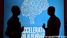 ARCHIV 2017 *** Participants at Intel's Artificial Intelligence (AI) Day stand in front of a poster during the event in the Indian city of Bangalore on April 4, 2017. / AFP PHOTO / MANJUNATH KIRAN (Photo credit should read MANJUNATH KIRAN/AFP/Getty Images)