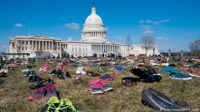 Shoes outside the US Capitol in Washington represent children killed by guns