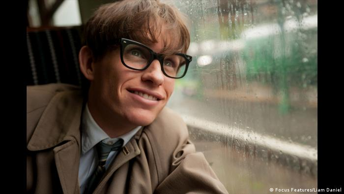 British actor Eddie Redmayne, as Stephen Hawking, peers out of a rainy train window in The Theory of Everything.