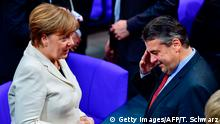 14.03.2018+++ German Chancellor Angela Merkel talks to outgoing German Vice-Chancellor and Foreign Minister Sigmar Gabriel as they arrive to attend the session for the election of the German Chancellor at the Bundestag (lower house of parliament) on March 14, 2018 in Berlin. Angela Merkel, head of the Christian Democratic Party CDU starts her fourth term as German chancellor, capping months of political uncertainty as she bartered with her rivals of the SPD to help govern Europe's top economy in a grand coalition. / AFP PHOTO / Tobias SCHWARZ (Photo credit should read TOBIAS SCHWARZ/AFP/Getty Images)