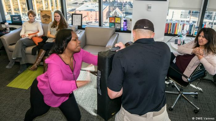 Danielle Bell practices attacking a coach during a course to learn how to behave if threatened by a shooter, in Denver, Colorado