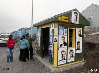 Election posters are seen on a bus shelter in Nuuk, Greenland
