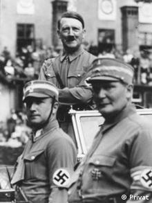 O Χανς Λούντιν ανάμεσα στον Χίτλερ και τον Χέρμαν Γκέρινγκ στο συνέδριο του Εθνικοσοσιαλιστικού Κόμματος στη Νυρεμβέργη το 1936