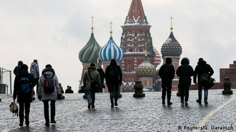 People walk in Red Square near St. Basil's Cathedral in central Moscow