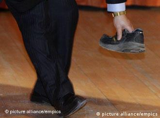 Chinese Premier Wen Jiabao visits UK.A security guard picks up a shoe that was thrown towards Chinese Premier Wen Jiabao at the University of Cambridge. ASSOCIATION Photo. Picture date Monday February 2 2009. Photo credit should read: Darren Staples/PA Wire URN:6833565