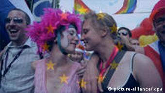 Two women participate in a gay pride parade