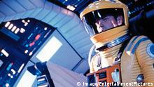 1968 - 2001: A Space Odyssey - Movie Set PICTURED: KEIR DULLEA. FILM TITLE: 2001: A SPACE ODYSSEY. DIRECTOR: Stanley Kubrick. PLOT: When the world was ruled by apes, one particular group discovers a mysterious rectangular monolith near their home, which imparts upon them the knowledge of tool use, and enables them to evolve into men. In the year 2001, a similar monolith is discovered on the moon, and is determined to have come from an area near Jupiter. Astronaut David Bowman, along with four companions, sets off for Jupiter on a spaceship controlled by HAL 9000, a revolutionary computer system that is every bit mankind s equal, and perhaps his superior. When HAL endangers the crew s lives for the sake of the mission, Bowman will have to first overcome the computer, then travel to the birthplace of the monolith, where whatever alien intelligence controls them decides that humanity PUBLICATIONxINxGERxONLY 19680506_mab_g90_570.jpg