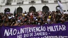 People hold a sign during a protest for the Rio de Janeiro's city councillor Marielle Franco, who was shot dead, outside the city council chamber in Rio de Janeiro, Brazil, March 15, 2018. The sign reads: No to the military intervention. REUTERS/Pilar Olivares