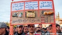 Moroccans shout slogans and carry placards during a demonstration against economic marginalisation on January 20, 2018, in the northeastern city of Jerada, 60 kilometres southwest of Oujda. The residents of the former mining town demonstrated to call for jobs and development after the accidental death of two brothers in a disused mine sparked mass protests. / AFP PHOTO / FADEL SENNA (Photo credit should read FADEL SENNA/AFP/Getty Images)