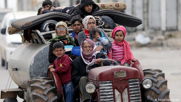 People fleeing Afrin on a tractor