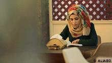 Zainab al-Jubouri, owner of the Cultural Cafe (Orama), reads her book and manages the affairs of the work