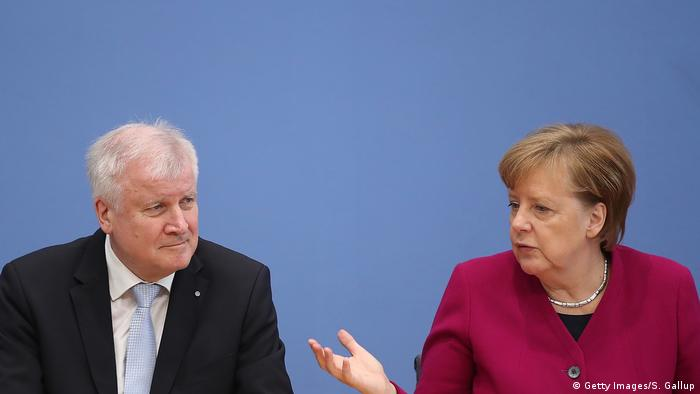 Interior Minister Horst Seehofer and Chancellor Angela Merkel