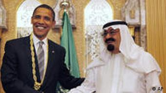 President Barack Obama shakes hands after receiving a gift from Saudi King Abdullah in Riyadh, Saudi Arabia in June 2009