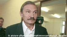 FILE - In this Tuesday, Dec. 19, 2000 file photo, ex-deputy director general of Aeroflot airlines company Nikolai Glushkov leaves the Lefortovsky court escorted by police officers, after the judge refused to release him on bail, in Moscow. British police say on Friday, March 16, 2018 they are treating the death of London-based Russian businessman Nikolai Glushkov as a homicide, after a post-mortem revealed he died from compression to the neck. Glushkov was an associate of Boris Berezovsky, a Russian oligarch and Kremlin critic who died under disputed circumstances in 2013. (Pavel Smertin/Kommersant Photo via AP, file) |