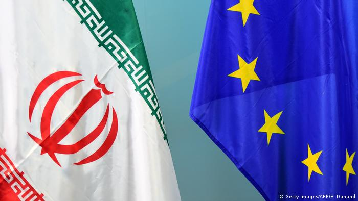 EU and Iranian flags (Getty Images/AFP/E. Dunand)