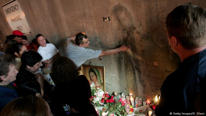 A man touches the image of the Virgin Mary in Chicago