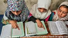 Indien - Kinder - Lesen (picture alliance/NurPhoto/Creative Touch Imaging Ltd)