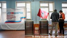 Memmbers of a local election commission prepare voting machines in a polling station ahead of Russia's presidential election, on March 17, 2018 in Moscow. Russians vote on March 18, a presidential election in which Vladimir Putin will seek a fourth term. / AFP PHOTO / Alexander NEMENOV (Photo credit should read ALEXANDER NEMENOV/AFP/Getty Images)