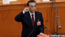 Chinese Premier Li Keqiang taking an oath of office (Reuters/J. Lee)