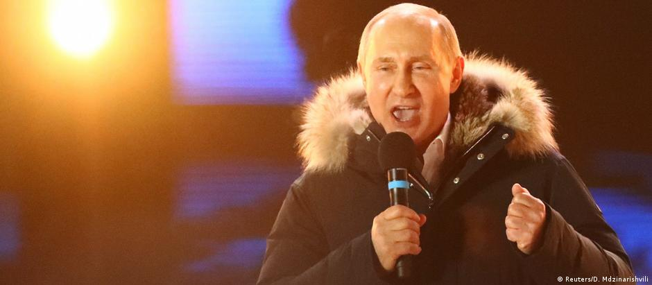 Russian President Vladimir Putin delivers a speech during a victory rally in Moscow