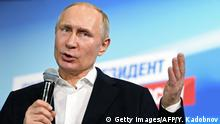 Presidential candidate, President Vladimir Putin speaks as he meets with confidants at his campaign headquarters in Moscow on March 18, 2018. / AFP PHOTO / Yuri KADOBNOV (Photo credit should read YURI KADOBNOV/AFP/Getty Images)