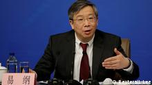 March 10, 2017. FILE PHOTO: Yi Gang, deputy central bank governor of the People's Bank of China, attends a news conference during the ongoing National People's Congress (NPC), China's parliament, in Beijing China March 10, 2017. REUTERS/Jason Lee/File Photo