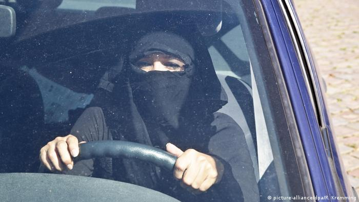 Woman driving with full face veil