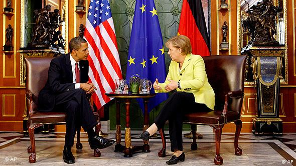 US President Barack Obama, and German Chancellor Angela Merkel are seen prior to bilateral talks at the historical Green Vault in Dresden, Germany, Friday June 5, 2009. Copyright: AP Photo/Michael Sohn