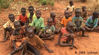 Children, who have become refugees as a result of the conflict in South Sudan, sitting on the ground