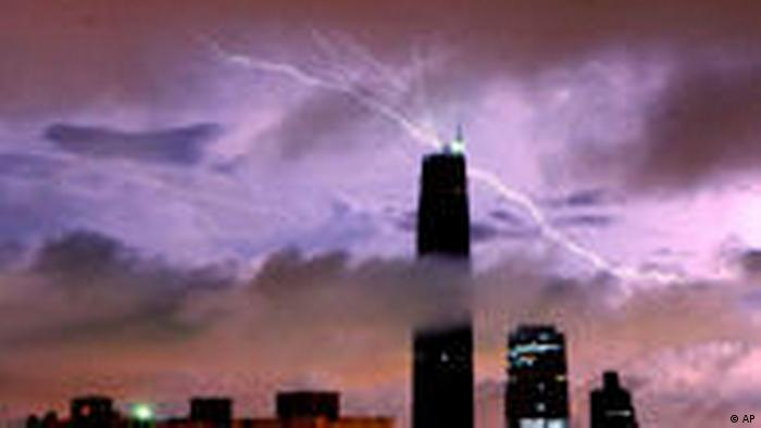 Lightning over Guangzhou International Finance Center during a rainstorm in Guangzhou, Guangdong province (AP)
