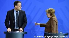 German Chancellor Angela Merkel and Irish Prime Minister Leo Varadkar leave after a news conference on their talks in Berlin on March 20, 2018 (TOBIAS SCHWARZ/AFP/Getty Images)