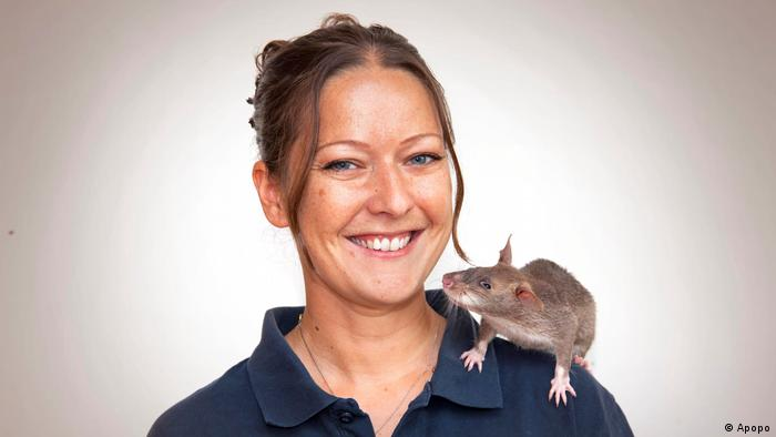 Portrait photo of Dr. Cindy Fast with a sniffer rat on her shoulder