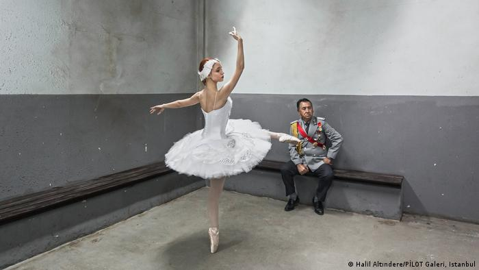 A dancer and police officer are shown in a snapshot of a video by artist Halil Altındere (Halil Altındere/PİLOT Galeri, Istanbul)