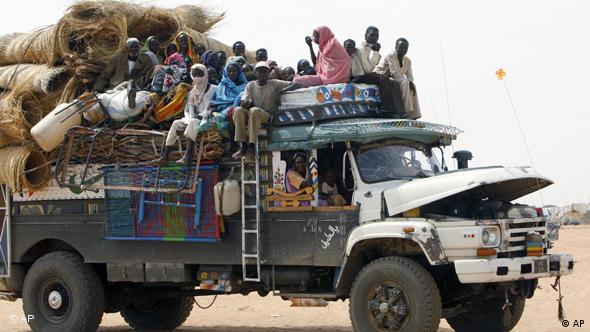 A truck loaded with new refugees enters Zamzam refugee camp, outside the Darfur town of al-Fasher, Sudan, Thursday, March 19, 2009. Tens of thousands newly displaced Sudanese have arrived at the overcrowded refugee camp of Zamzam in the last several weeks. (AP Photo/Nasser Nasser)