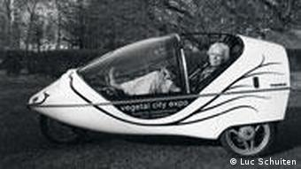 Luc Schuiten seated in his electric-powered car