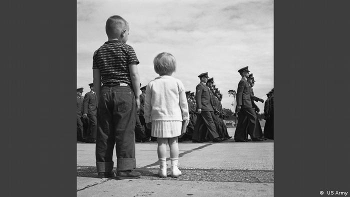 Two kids at a military parade in the exhibition Little America in the allied Museum. ( US Army)