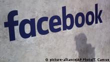 Facebook with a shadow (picture-alliance/AP Photo/T. Camus)