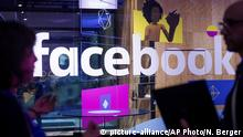 18.04.2017 Conference workers speak in front of a demo booth at Facebook's annual F8 developer conference, Tuesday, April 18, 2017, in San Jose, Calif. (AP Photo/Noah Berger) |
