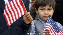 18.05.2016 Iker Velasquez, 4, who came from Honduras with his parents, holds a U.S. glad as he listens while Rep. Luis Gutierrez, D-Ill., speaks to the media with children and families from Central America, to speak about the conditions for Central American immigrants who he describes as refugees from violence, during a news conference on Capitol Hill in Washington, Wednesday, May 18, 2016. (AP Photo/Jacquelyn Martin) |