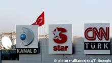 Logos for three media outlets owned by Dogan Holding Company