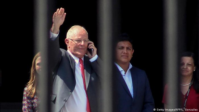 Former Peruvian President Pedro Pablo Kuczynski waves to onlookers as he leaves the presidential palace after announcing his resignation.