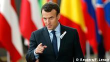 France's President Emmanuel Macron gestures as he arrives at a European Union leaders summit in Brussels, Belgium, March 22, 2018. REUTERS/Francois Lenoir