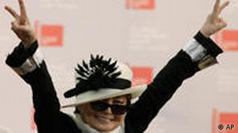 Yoko Ono flashing the victory sign after receiving the Golden Lion career award