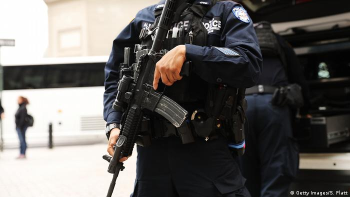 A police officer stands guard