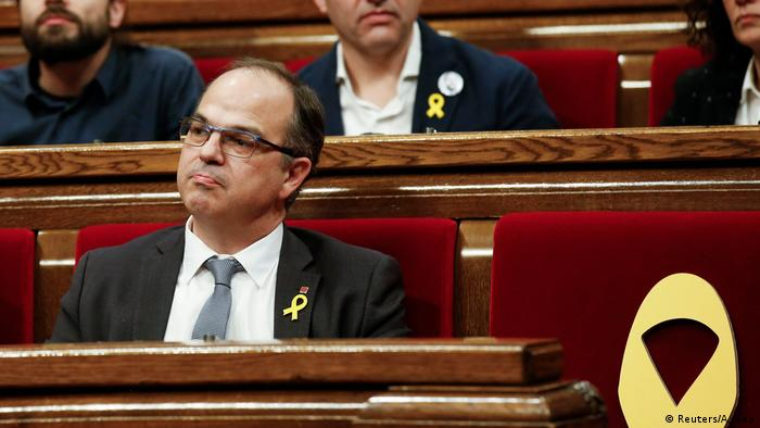 Catalan separatists face charges as key figure flees overseas
