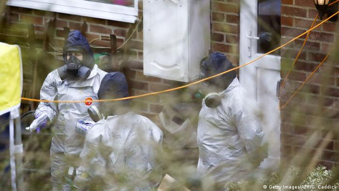 Investigators work in the garden of Sergei Skripal's house in Salisbury, southern England