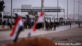 Buses waiting to evacuate civilians and rebels from eastern Ghouta (Reuters/O. Sanadiki)